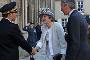 British Prime Minister Theresa May arrives for the Royal British Legion Service of Remembrance at Bayeux Cathedral, as part of commemorations for the 75th anniversary of the D-Day landings on June 6, 2019 in Bayeux, France. Veterans, families, visitors, political leaders and military personnel are gathering in Normandy to commemorate D-Day, which heralded the Allied advance towards Germany and victory about 11 months later.