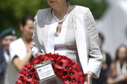 British Prime Minister Theresa May lays a wreath during the Royal British Legion Service of Remembrance at the Commonwealth War Graves Cemetery on June 6, 2019 in Bayeux, France. Veterans and families gathered in Normandy to commemorate D-Day's 75th anniversary. It has been announced that 16 countries had signed a historic proclamation of peace to ensure the horrors of the Second World War are never repeated. The text has been agreed by Australia, Belgium, Canada, Czech Republic, Denmark, France, Germany, Greece, Luxembourg, Netherlands, Norway, New Zealand, Poland, Slovakia, the United Kingdom and the United States of America.