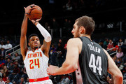 Kent Bazemore #24 of the Atlanta Hawks attempts a shot against Tyler Zeller #44 of the Brooklyn Nets at Philips Arena on January 12, 2018 in Atlanta, Georgia.  NOTE TO USER: User expressly acknowledges and agrees that, by downloading and or using this photograph, User is consenting to the terms and conditions of the Getty Images License Agreement.
