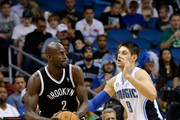 Nikola Vucevic #9 of the Orlando Magic plays defense against Kevin Garnett #2 of the Brooklyn Nets during the game at Amway Center on November 3, 2013 in Orlando, Florida.  NOTE TO USER: User expressly acknowledges and agrees that, by downloading and/or using this Photograph, user is consenting to the terms and conditions of the Getty Images License Agreement.