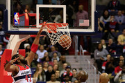 Nene Hilario #42 of the Washington Wizards dunks over Kevin Garnett #2 and Jarrett Jack #0 of the Brooklyn Nets during the first half at Verizon Center on January 16, 2015 in Washington, DC. NOTE TO USER: User expressly acknowledges and agrees that, by downloading and or using this photograph, User is consenting to the terms and conditions of the Getty Images License Agreement.