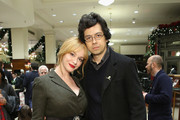Actors Christina Hendricks and Geoffrey Arend attend an evening hosted by Brooks Brothers to celebrate the holidays with St. Jude Children's Research Hospital at Brooks Brothers on December 13, 2016 in New York City.
