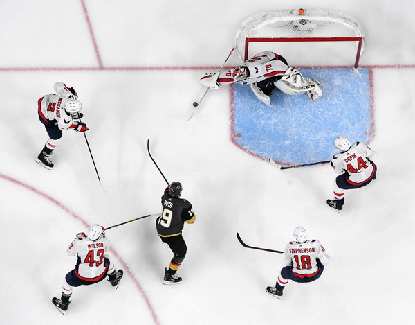2018 NHL Stanley Cup Final - Game Two [game two,shot,ice hockey,ice hockey position,hockey,college ice hockey,team sport,stick and ball games,hockey protective equipment,ice rink,ice hockey equipment,player,braden holtby,reilly smith,brooks orpik,tom wilson,nhl,washington capitals,vegas golden knights,stanley cup final]