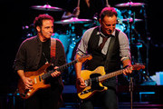 Nils Lofgren and Bruce Springsteen perform at Consol Energy Center on October 27th, 2012 in Pittsburgh, Pennsylvania.