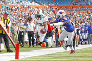 Reggie Bush #22 of the Miami Dolphins reaches out as he scores his first of three touchdowns against the Buffalo Bills on December 23, 2012 at Sun Life Stadium in Miami Gardens, Florida. The Dolphins defeated the Bills 24-10.