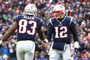 Tom Brady #12 of the New England Patriots high fives Dwayne Allen #83 during the third quarter of a game against the Buffalo Bills at Gillette Stadium on December 24, 2017 in Foxboro, Massachusetts.