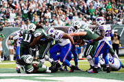 Chris Ivory #33 of the New York Jets scores a touchdown against the Buffalo Bills in the second quarter at MetLife Stadium on October 26, 2014 in East Rutherford, New Jersey.