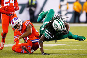 Chris Ivory #33 of the New York Jets is tripped up by Duke Williams #27 of the Buffalo Bills during the third quarter at MetLife Stadium on November 12, 2015 in East Rutherford, New Jersey. The Buffalo Bills defeated the New York Jets 22-17.