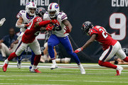 Chris Ivory #33 of the Buffalo Bills rushes with the ball as Justin Reid #20 of the Houston Texans and Johnathan Joseph #24 attempt to tackle in the second half at NRG Stadium on October 14, 2018 in Houston, Texas.