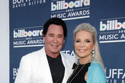 Singer Wayne Newton and Kathleen McCrone arrive at the Buffalo David Bitton red carpet at the 2013 Billboard Music Awards at the MGM Grand Garden Arena on May 19, 2013 in Las Vegas, Nevada.
