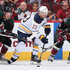 Niklas Hjalmarsson Photos - Sam Reinhart #23 of the Buffalo Sabres skates with the puck ahead of Niklas Hjalmarsson #4 of the Arizona Coyotes during the third period of the NHL game at Gila River Arena on October 13, 2018 in Glendale, Arizona. The Sabres defeated the Coyotes 3-0. - Buffalo Sabres v Arizona Coyotes