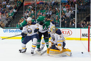 Jamie Benn #14 of the Dallas Stars and Tyler Seguin #91 of the Dallas Stars score a goal against Anders Lindback #35 of the Buffalo Sabres as Tyson Strachan #24 of the Buffalo Sabres defends in the first period at American Airlines Center on March 23, 2015 in Dallas, Texas.