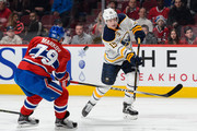 Andrei Markov #79 of the Montreal Canadiens blocks the shot of Jack Eichel #15 of the Buffalo Sabres during the NHL game at the Bell Centre on February 3, 2016 in Montreal, Quebec, Canada.
