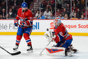 Mike Condon #39 of the Montreal Canadiens gloves the puck near teammate Andrei Markov #79 during the NHL game against the Buffalo Sabres at the Bell Centre on February 3, 2016 in Montreal, Quebec, Canada.