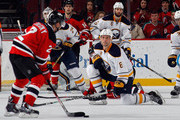 Cody McCormick #8 of the Buffalo Sabres goes to a knee to block a shot by Marek Zidlicky #2 of the New Jersey Devils during the third period at the Prudential Center on January 6, 2015 in Newark, New Jersey. The Devils defeated the Sabres 4-1.