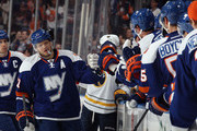 Kyle Okposo #21 of the New York Islanders celebrates his powerplay goal at 6:37 of the first period against the Buffalo Sabres at the Nassau Veterans Memorial Coliseum on April 4, 2015 in Uniondale, New York.