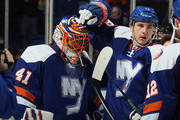 Ryan Strome #18 (l) congratulates Jaroslav Halak #41 of the New York Islanders on his 3-0 shut out against the Buffalo Sabres at the Nassau Veterans Memorial Coliseum on April 4, 2015 in Uniondale, New York.