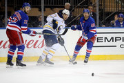 Jordan Nolan #17 of the Buffalo Sabres, Kevin Shattenkirk #22 and Michael Grabner #40 of the New York Rangers watch the puck in the third period during their game at Madison Square Garden on January 18, 2018 in New York City.