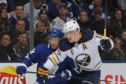 Jack Eichel #15 of the Buffalo Sabres battles against Tomas Plekanec #19 of the Toronto Maple Leafs during an NHL game at the Air Canada Centre on April 2, 2018 in Toronto, Ontario, Canada.