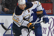 Kyle Okposo #21 of the Buffalo Sabres skates with the puck against the Toronto Maple Leafs during an NHL game at the Air Canada Centre on April 2, 2018 in Toronto, Ontario, Canada. The Maple Leafs defeated the Sabres 5-2.