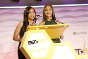 Singer-songwriter Cymphonique Miller and Rapper Saweetie speak onstage during the BET Her Awards Presented By Bumble at Conga Room on June 21, 2018 in Los Angeles, California.