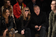 (L-R) Jourdan Dunn, Kate Moss and Mario Testino attend the Burberry Prorsum AW 2015 show during London Fashion Week at Kensington Gardens on February 23, 2015 in London, England.