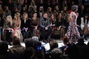 (L-R) Kim Min Hee, Lily Donaldson, Paloma Faith, Clemence Posey, Maggie Gyllenhaal, Sam Smith, Cara Delevingne, Jourdan Dunn, Kate Moss, Mario Testino and Naomi Campbell attend the Burberry Prorsum AW 2015 show during London Fashion Week at Kensington Gardens on February 23, 2015 in London, England.