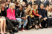 (L to R) Dan Gillespie, Ellie Goulding, Kanye West, Sienna Miller, Gemma Arterton, Rosie Huntington-Whiteley, Mario Testino, Andy Murray and Kim Sears attends at the Burberry Spring Summer 2012 Womenswear Show at Kensington Gardens on September 19, 2011 in London, England.