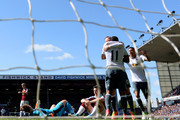Anthony Martial of Manchester United celebrates with Wayne Rooney after scoring the opening goal as Thomas Heaton and Joey Barton of Burnley show their dejection during the Premier League match between Burnley and Manchester United at Turf Moor on April 23, 2017 in Burnley, England.