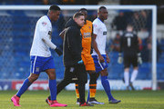 Kelvin Etuhu (1st L) of Bury leaves the pitch after picking up injury during The Emirates FA Cup fourth round match at between Bury and Hull City at Gigg Lane on January 30, 2016 in Bury, England.