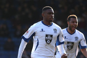 Kelvin Ethuhu of Bury celebrates after scoring his sides 1st goal during the Sky Bet League Two match between Bury and Northampton Town at The JD Stadium on March 21, 2015 in Bury, England.
