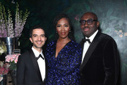 (L-R) Imran Amed, Tiwa Savage and Edward Enninful at the gala dinner in honour of Edward Enninful, winner of the Global VOICES Award 2019, during #BoFVOICES on November 22, 2019 in Oxfordshire, England.