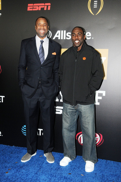 Allstate Party At The Playoff [suit,premiere,event,outerwear,carpet,formal wear,tie,flooring,greg buckner,c.j. spiller,carpet,florida,tampa,allstate party,l,playoff]