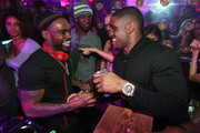 """DJ Stevie J (L) greets running back Reggie Bush (R) of the Detroit Lions at """"LIV on Sundays"""" presented by TAO Takeover Party at CAKE Nightclub on February 1, 2015 in Scottsdale, Arizona."""