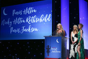 (L-R) Paris Hilton, Nicky Hilton Rothschild and Paris Jackson speak onstage during the CASA Of Los Angeles' 2018 Evening To Foster Dreams Galaat The Beverly Hilton Hotel on April 18, 2018 in Beverly Hills, California.