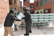 Former professional baseball player CC Sabathia (2nd L) distributes pantry boxes to Boys And Girls Club families at the Belmont Community Day Care Center on April 08, 2020 in The Bronx Borough of New York City.
