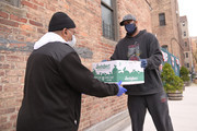 Former professional baseball player CC Sabathia (R) distributes pantry boxes to Boys And Girls Club families at the Belmont Community Day Care Center on April 08, 2020 in The Bronx Borough of New York City.