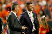 Tim Tebow and Urban Meyer Photos Photo