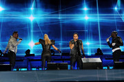 """apl.de.ap, Fergie, Taboo  and  will.i.am  of the Black Eyed Peas perform onstage during CHASE Presents The Black Eyed Peas and Friends """"Concert 4 NYC"""" benefiting the Robin Hood Foundation at Central Park, Great Lawn on September 30, 2011 in New York City."""