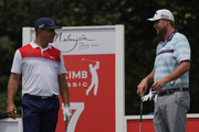 Marc Leishman (R) of Australia and Gary Woodland of United States at the 7th hole during the third round of the CIMB Classic at TPC Kuala Lumpur on October 13, 2018 in Kuala Lumpur, Malaysia.