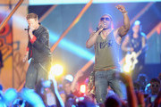 Florida Georgia Line and Nelly perform onstage during the 2013 CMT Music awards at the Bridgestone Arena on June 5, 2013 in Nashville, Tennessee.