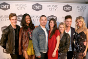 """Cast members Bryant Lowry, Alisa Beth, Kerry Degman, Rachyl Degman, Jessica Mack, Jackson Boyd and Sarah Thomas attend CMT's """"Music City"""" premiere party on February 20, 2018 in Nashville, Tennessee."""