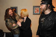 Singers & Songwriters Jamey Johnson, Kellie Pickler and Randy Houser pose for photographs backstage during the CMT Tour at the Wildhorse Saloon on December 8, 2009 in Nashville, Tennessee.