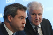 In this image shot through a pain of glass Horst Seehofer (R), Chairman of the Bavarian Social Union (CSU), and Markus Soeder, Governor of Bavaria and lead candidate of the CSU in yesterday's Bavarian state elections, arrive for a meeting of the CSU leadership at party headquarters on October 15, 2018 in Munich, Germany. The CSU faired poorly in the election, winning 37.2% of the vote, 10.5 votes fewer than in the last election. The CSU has long been Bavaria's strongest party but will now face the arduous task of forming a state government coalition.