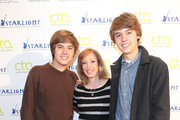 (l-r) Actors Dylan Sprouse and Cole Sprouse pose for a photo with casting director Joey Paul Jensen before teaching a Master Workshop on acting, hosted by Celebrity Talent Academy and Starlight Childrens Foundation at the Cochrane Theatre on  January 29, 2011 in London, England.