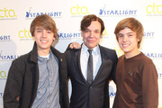 (l-r) Actors Cole Sprouse and Dylan Sprouse pose for a photo with George Caceres before teaching a Master Workshop on acting, hosted by Celebrity Talent Academy and Starlight Children's Foundation at the Cochrane Theatre on  January 29, 2011 in London, England.