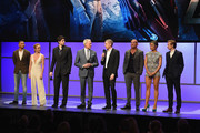 (L-R) Actors Franz Drameh, Caity Lotz, Brandon Routh, Victor Garber, Wentworth Miller, Dominic Purcell, Ciara Renee and Arthur Darvill speak onstage at the CW Network's 2015 Upfront presentation at New York City Center on May 14, 2015 in New York City.