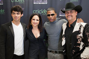 """Mentors Joe Jonas, Gloria Estefan, Nelly and John Rich from the CW's """"The Next"""" pose for a photo before a live taping on August 7, 2012 in Dallas, Texas."""