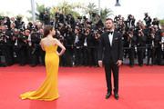 US actress Anna Kendrick (L) and US singer Justin Timberlake pose as they arrive on May 11, 2016 for the opening ceremony of the 69th Cannes Film Festival in Cannes, southern France.  / AFP / Valery HACHE