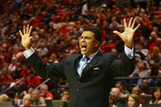 Head coach Reggie Theus of the Cal-State Northridge Matadors directs his team from the bench in the first half of the game against the San Diego State Aztecs at Viejas Arena on November 14, 2014 in San Diego, California.